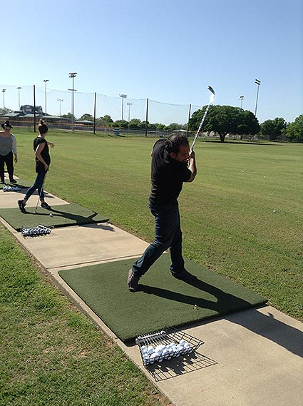 Ahsan hitting the ball off the course during Central Station Marketing's team outing.